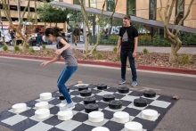 Students, Steven Deley and Dahlia Stott play checkers at the ASU Open Door event at the Downtown campus