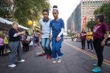 Julian Britt, 15, his mother, Yolanda Britt, of Glendale, are in sync as they double-jumping rope at the Downtown Phoenix campus' ASU Open Door, on Friday, Feb. 2, 2018