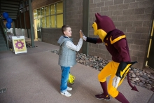 Sparky greets visitors to the Open Door at Polytechnic Campus in Mesa, Ariz. on Friday evening January 26th, 2018.