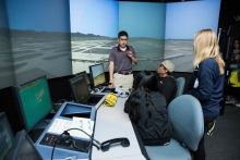 Air traffic management senior Nathan Kishiyama explains aspects of the Air Traffic Control Lab to the Raaman family during the ASU Open Door at Polytechnic Campus in Mesa, Ariz. on Friday evening January 26th, 2018.